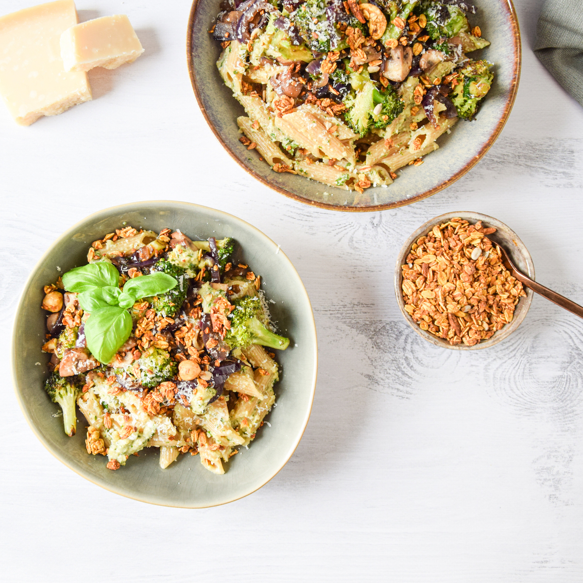 Penne with pesto, broccoli and mushrooms with turmeric quinoa granola