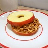 Apple sandwich with peanut butter and XAVIES' granola