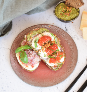 Toast with green pesto, mozzarella and prosciutto and XAVIES' Pure Toasted Seeds